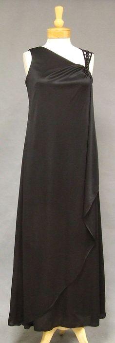 > Asymmetrical Black Jersey 1970's Evening Gown, $179.00   Vintageous, LLC (http://www.vintageous.com/asymmetrical-black-jersey-1970s-evening-gown/)
