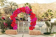 Giant flower trellis is fabulously bold.  Queen of Cabo Mexican Inspired 50th Birthday Party