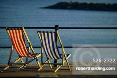 Two deckchairs on the seafront, Sidmouth, Devon, England, UK, Europe