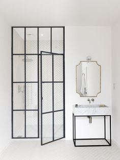 Luxury master bathroom by Studio Maclean West London with steel-framed shower door. Chris-tubbs-photo.