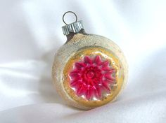 This vintage Shiny Brite Merry Christmas ornament is a silver glass double indent ornament with hot pink centers. The indent is surrounded with