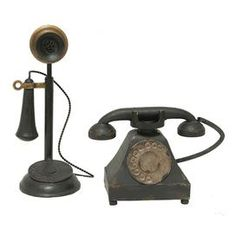 """2-piece antique-inspired telephone decor set.   Product: Small and large telephone décor Construction Material: Metal  Color: Black and goldDimensions: Small: 7"""" H x 9"""" W x 4.5"""" DLarge: 13.25"""" H x 5.25"""" DiameterCleaning and Care: Wipe with a damp cloth"""