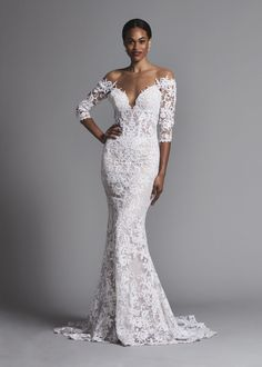 Sexy off-the-shoulder lace 3/4 sleeve sheath wedding dress. | Pnina Tornai | Style: 4576