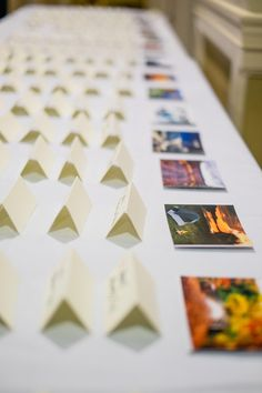 Instead of table numbers, this couple used pictures of significant places and things from their relationship {Under Grace Photo}