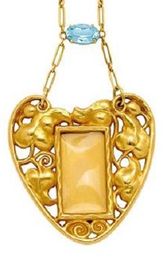 An Art Nouveau Aquamarine and Gold Heart Pendant, circa 1910. The openwork heart-shaped pendant embellished by repoussé leaves and coiling whiplash tendrils, centring a rectangular glazed window, sliding panel to the reverse, in 18k gold, and joined to a 14k gold chain of elongated linking accented by an oval aquamarine connector.