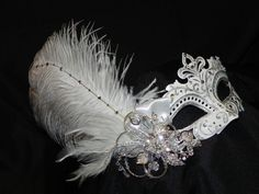 New to TheCraftyChemist07 on Etsy: White and Silver Capri Feather Mask (110.00 USD)