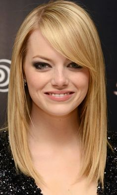 Long Haircut: Emma Stone's Sweeping Fringe Adds Interest To Naturally Fine Hair, 2012