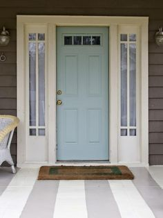 With a grey exterior and black shutters?  Front door is Benjamin Moore's Wythe Blue