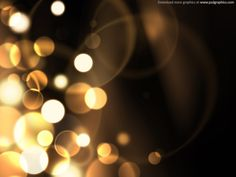 Abstract blurry sparkles background, defocused yellow particles on a dark background.
