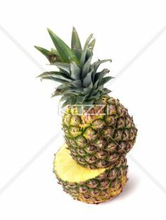 pineapple cut in half - A pineapple on white that has been cut in two pieces showing one on top of the other