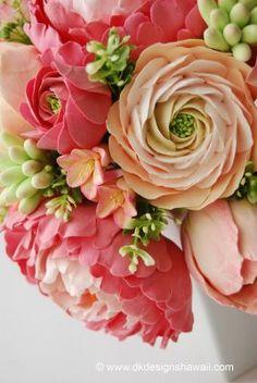 Coral pink and peach peonies, ranunculus, hyacinth and tuberose