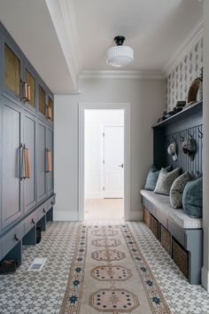 Charming Mudroom Patterned Tile Flooring Built-in Storage Farmhouse Interior Design Mudroom Bench Unique Hardware Pulls Blue Cabinetry Mudroom Ideas Shoe Storage Family Storage Laundry Room Tribal Runner Rug Quinta Interior, Mudroom Laundry Room, Bench Mudroom, Farmhouse Interior, Farmhouse Flooring, Home Remodeling, Building A House, New Homes, House Design