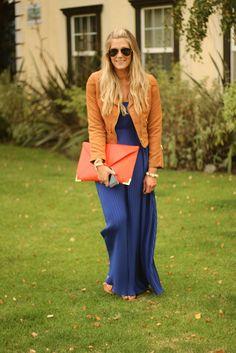 Blue maxi, tan leather jacket & orange clutch.