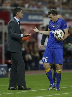 Juventus' Stephan Lichtsteiner, right, argues with Olympiacos' head coach Michel during a Champions League Group A soccer match between Olympiakos and Juventus at Georgios Karaiskakis Stadium in the port of Piraeus near Athens, Wednesday, Oct. 22, 2014. (AP Photo/Thanassis Stavrakis) | View photo - Yahoo News India
