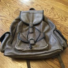 Leather Backpack Cowhide leather backpack. Weathered and worn… But in great condition. All hardware is in perfect condition. Interior is lined and completely intact, no tears or holes. Very large and roomy and solid. Bags Backpacks