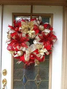 Red and gold poinsettia Christmas wreath! Contact Designs by Sammy! Designsbysammywithlove@gmail.con