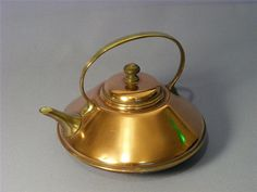 """A lovely Arts & Crafts Benham & Froud copper spirit kettle C 1880  Wonderful stylish shape  Brass handle & spout  Made by famous metal workers """"Benham & Froud""""  It is clearly marked with the Benham trade mark { the orb of Saint Paul's Cathedral } to underside"""