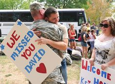 Brandon Keisker gives his father, Sgt. 1st Class David Keisker, a hug with his sister, Kelsey, before the troops gathered for formation. More than 450 Missouri National Guard troops returned home Saturday after a one-year security mission in Qatar.
