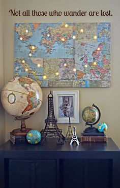 Love how this basic map us hung up with lights and then various travel pieces in front. Use this as inspiration in the travel theme classroom!