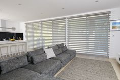 Pirouette Shadings - Luxaflex Pirouette Shadings provide softly curved, elegant horizontal fabric vanes attached to a sheer backing for an enhanced way of controlling light and privacy.