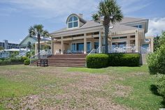 7806 Beach Drive Myrtle Beach, SC 29572,  with a price of $2395000, 4 bedrooms, 5.00 bathrooms, 6050 square feet of construction and 0.3475 acres of land.