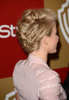 Julianne Hough Proves How Versatile a Bob Can Be: A casual headband braid was Julianne's style of choice while visiting Philadelphia for the premiere of Safe Haven in January.  : At the 2013 Golden Globe Awards, Julianne Hough opted for a swept-up, voluminous pompadour.  : The back of her hair was twisted and pinned back, giving the sides a flattened look.