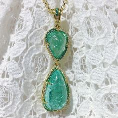 Excited to share our Paraìba tourmaline cabochon pendant! Accented with Paraìba rounds and round diamonds set in 18k yellow gold. Prestige salon 58. #omiprive #paraiba #tourmaline #paraibatourmaline #pendant #gold #diamonds #gemstones #gems #gem #jewel #jck #jcklasvegas #jck2014 #color