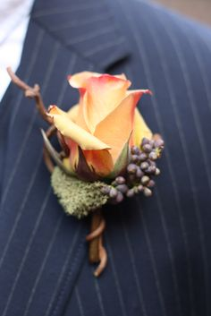 beautiful boutonniere with twig, moss, and vine
