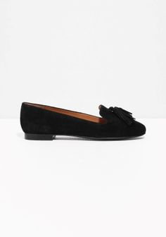 Suede upper lends softness to these slippers featuring a low on-the-go heel and two dangling tassles.