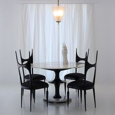 Dining suite produced by Pozzi & Verga, Italy c1940′s. Black lacquered timber construction with Calacatta and Verde Issorie marble. Chairs upholstered in Italian satin.