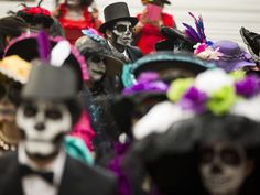 People dressed as La Calavera Catrina commemorate the Day of the Dead, a holiday that honors the deceased, during a Catrina Fest in Mexico City. The figure of a skeleton wearing an elegant broad-brimmed hat was first done as a satirical engraving by artist Jose Guadalupe Posada sometime between 1910 and his death in 1913.   Esteban Felix, AP