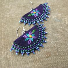 Delicate embroidered flowers decorate the body of these dainty fiber art earrings with a beaded edging. Deep eggplant purple ultrasuede forms the body of these earrings. Little Flowers, Purple Flowers, Flower Earrings, Crochet Earrings, Eggplant Purple, Green Cotton, Embroidered Flowers, Beaded Embroidery, Fiber Art