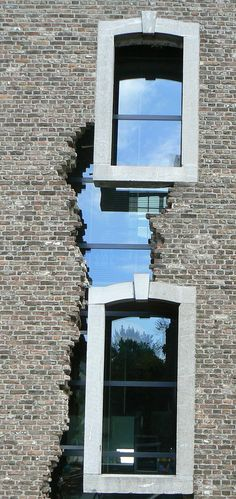 Window glass infiled into broken brick wall -- in Maastricht, Netherlands.