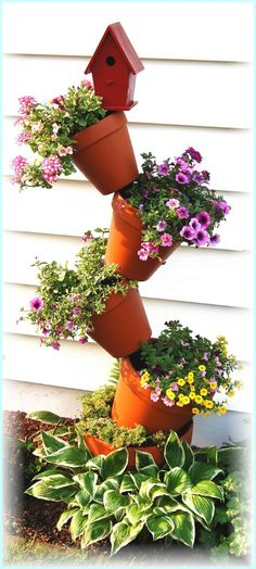 DIY Tipsy Vertical Pot Planter Projects & Instructions: Bucket, Container Gardening, Hanging Flower Pot, Flower Tower, Bath Tub Flower Tower Fountain and Garden Yard Ideas, Garden Crafts, Lawn And Garden, Garden Projects, Garden Art, Garden Design, Tower Garden, Garden Totems, Garden Junk