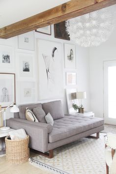 Light living room with gallery wall & exposed beams