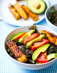 A perfect healthy #vegan dish! Kale and avocado bowl with spicy miso dipped tempeh. YUM.