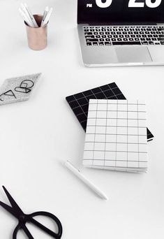 Make these modern and minimal notebooks, using the free printable grid paper download, plus the tutorial.