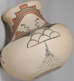 Buff vase with vivid orange, terra cotta and black paints featuring traditional weather patterns (rain, cloud, lightning) by #SantaClara/#Pojaque artists Lois and Derek de la Cruz