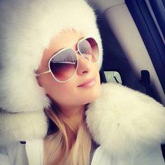 Paris Hilton wore a white ensemble to go skiing in Aspen.