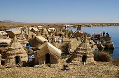 Totora reed houses and boats in the Uros Islands, Lake Titicaca