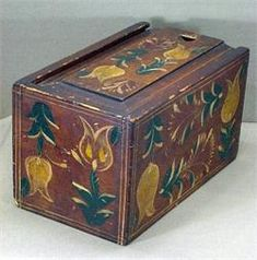 """A superb Paint Decorated Pennsylvania Candle Box in its' original untouched museum condition…Each panel is exuberantly decorated with stylized tulips and whimsical red pomegranates…both accented with green and white foilage within mustard This box has a square nailed construction, which is still visible on the underside…The mate to this box can be viewed at The Metropolitan Museum Of Art in New York City… Just a Magnificent Pennsylvania Painted Box!!! …Ht 8 1/4"""" Length 14 1/2"""" Width 8 1/2""""."""
