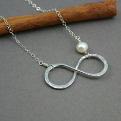 really want an infinity necklace for my birthday. one with a pearl too since its my birthstone