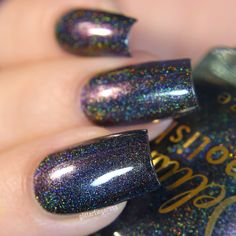 A blackened linear holo, accented with color shifting shimmer that's bound to bring out your wicked side. This listing is for a full sized 15ml bottle. Swatches: Delicious Nails / De_Briz / Shanna's N