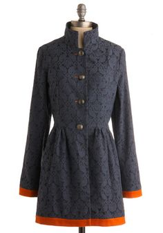 Prussian blue, cut from a darling damask and contrasted boldly with orange colorblocking at the long sleeves and bottom hem