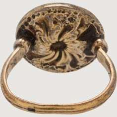 SIGNET RING WITH A SQUIRREL England? 13th-14th century with later additions (hoop) Gold (alloy) Weight 8.4 gr; bezel diameter 18 mm; circumference 56 mm; US size 7¾; UK size P½ This bezel of this ring is a Gothic seal matrix of the thirteenth or fourteenth century that was combined at a later date (post-Renaissance?) with a hoop in order to transform the matrix into a ring.