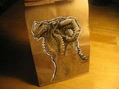 I love this style, b/w on craft paper.  This artist draws on his kids' lunch bags every day!