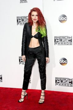 Bella Thorne.. Anthony Franco suit separates, Stuart Weitzman heels, leather bra, and body chain..