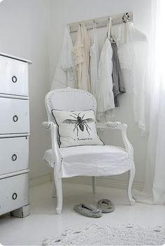 like the rings as drawer pulls and the white on white clothes rack