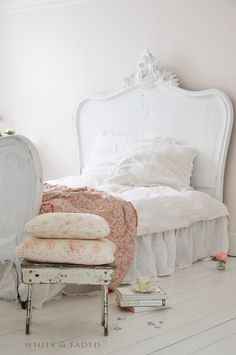 Beautiful vintage Eiderdown and Eiderdown cushions on chippy stool
