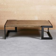 Made from steel and solid oak, the Hamilton Coffee Table brings a bit of warmth to the sometimes frigid world of modern furniture. Steel frames are welded, ground and brushed by hand, softening the feel of an otherwise brutal material. The wood— r...